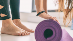 Yoga mat in fitness class for health and wellness including healthy feet