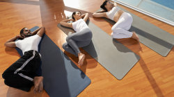 Yoga students practicing Supine Spinal Twist Pose (Supta Matsyendrasana) for happy and healthy hips