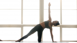yoga woman doing Gate exercise, Parighasana pose