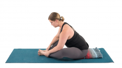 Woman practicing bound angle yoga pose to relieve high blood pressure