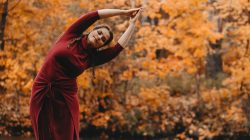 Yoga student in nature experiencing the abundance of life