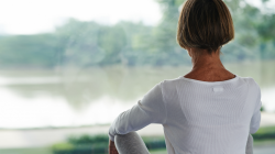 Woman sitting in meditation with good posture by practicing yoga spinefulness for back care health