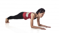 Woman practicing beginner yoga plank pose for core strength