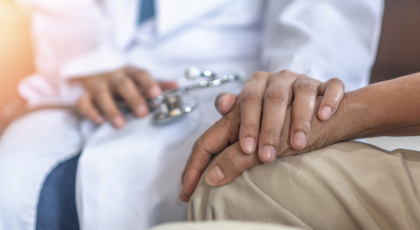 Parkinson's disease patient, being comforted by a healthcare provider