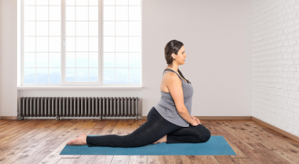 Student practicing pigeon pose