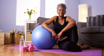Older beginner yoga student practicing yoga for menopause support