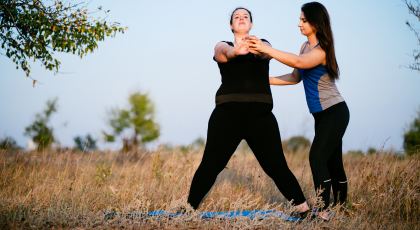 Yoga teacher teaching student with chronic pain