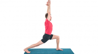 man practicing yoga standing pose warrior 1