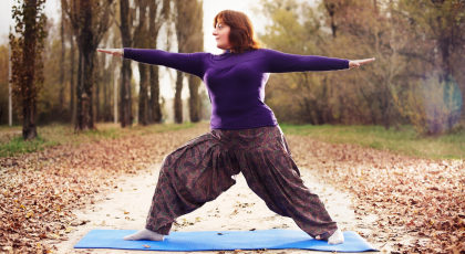 Woman practicing yoga for pain care Warrior II Pose (Virabhadrasana II)
