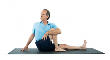 yoga man doing seated twist for digestion