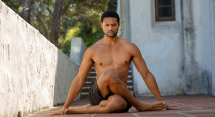 Yoga man in Cow Leg Pose (Gomukhasana) for back pain and sciatica