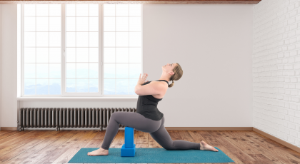Woman practicing yoga quadriceps Low Lunge Pose (Anjaneyasana)