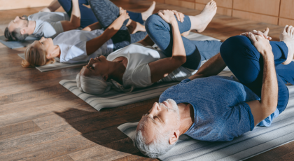 Yoga class for preventing chronic disease in Wind-Relieving Pose (Apanasana)