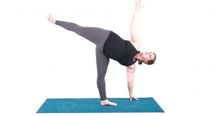 yoga woman doing half moon pose