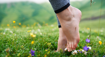 barefoot feet do yoga in field to develop brain