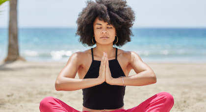 Woman practicing yoga for steadiness in Seated Pose