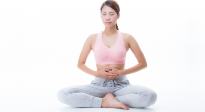 Woman practicing belly breathing yoga