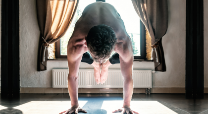 yoga student practicing bakasana kakasana crow pose