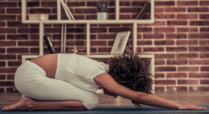 Woman practicing yoga in Child's Pose (Balasana) for back pain