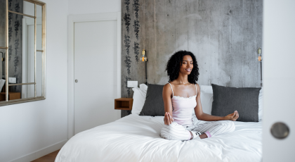 Woman practicing yoga for better sleep in seated pose