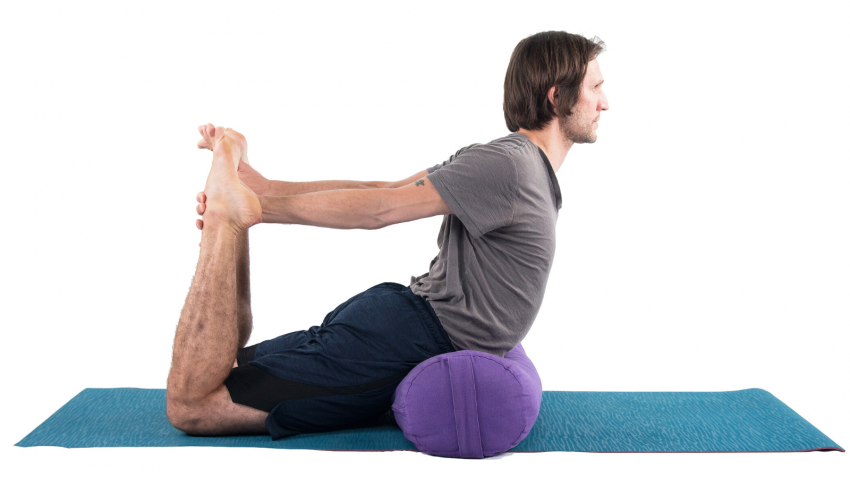Man practicing yoga in Bow pose