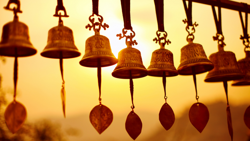 Nepali traditional Bells over the sun at sunset