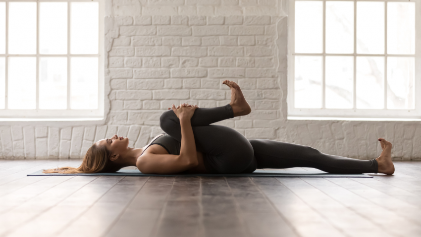 The benefits of practicing a simple traction technique with yoga strap to ease low back pain