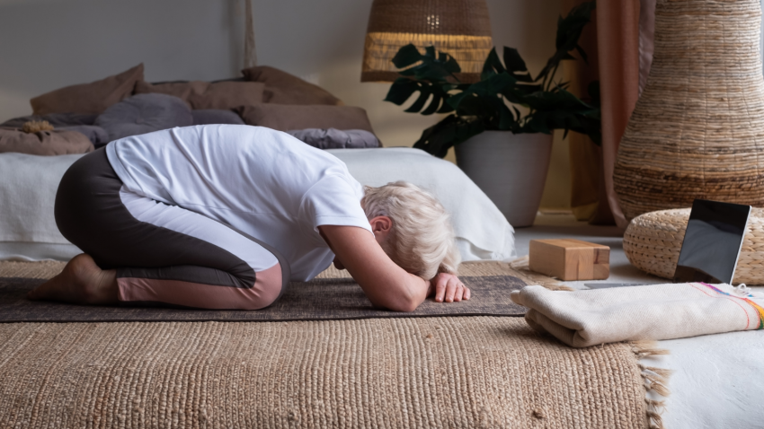 How to practice yoga to promote wellbeing and self-care in Child's Pose (Balasana)