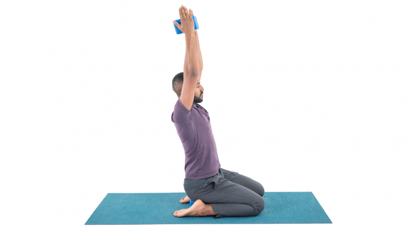 Man practicing shoulder opening yoga pose to prepare for handstand