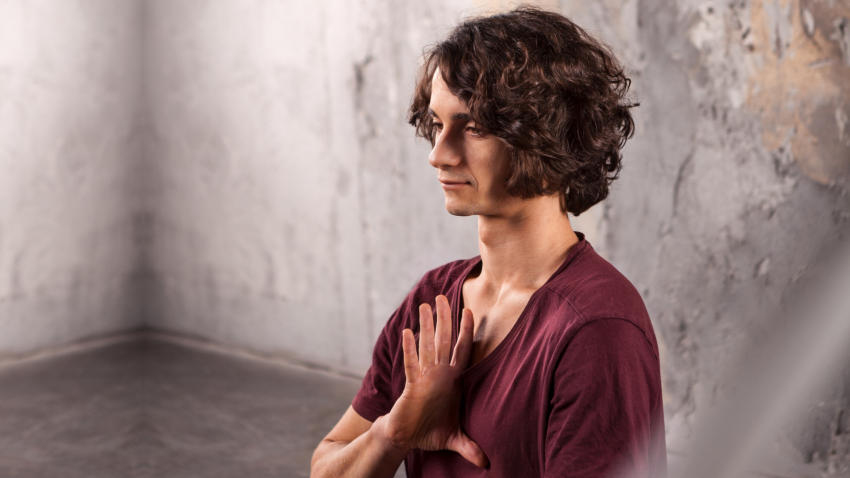 Man finding calm in meditation pose
