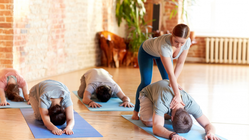 yoga instructor leading yoga class for students with chronic pain