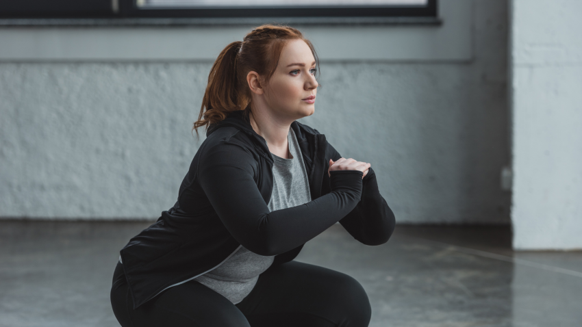 Full bodied woman doing chair pose Yoga Practice Positively Influence Body Image