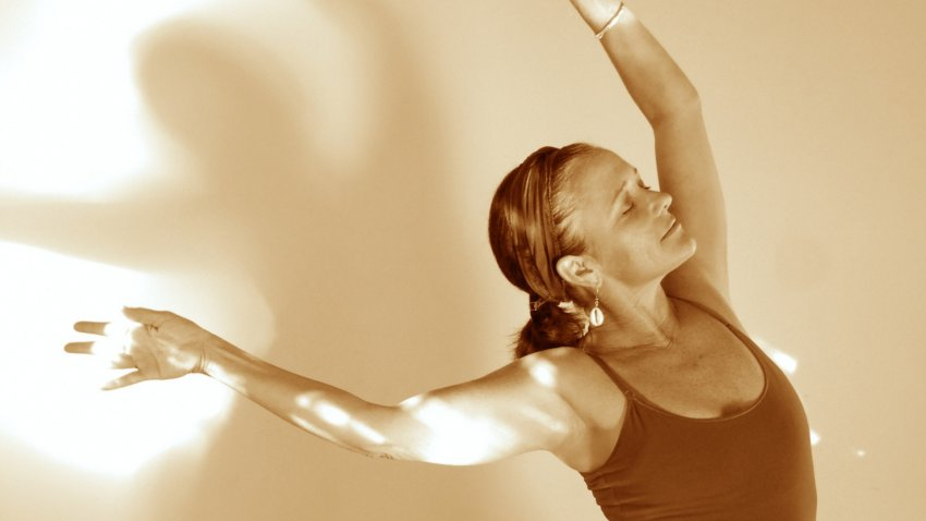 A woman dancing in the sunlight, due to the fascia or connective tissue