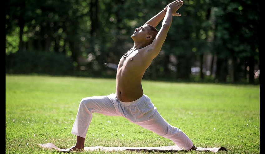 Man practicing yoga in Warrior I Pose (Virabhadrasana I)