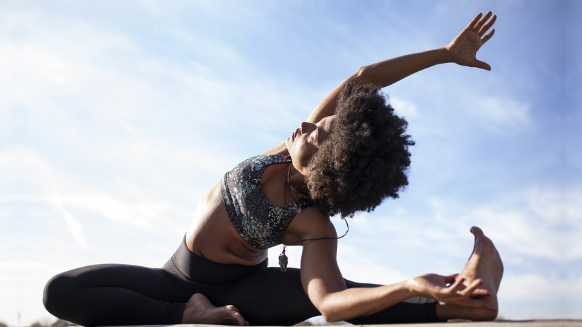 Woman practicing yoga for back pain side stretch