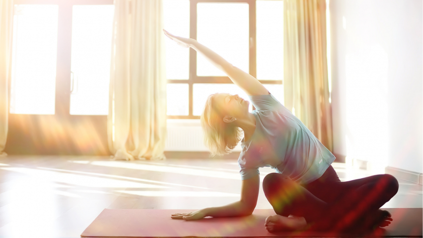 woman practicing yoga for cancer to help alleviate lymphedema