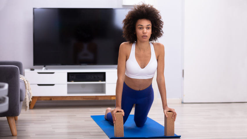 Woman practicing yoga for healthy wrists