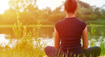 Young girl practices yoga on the shore of the River, concept of enjoying privacy, concentration