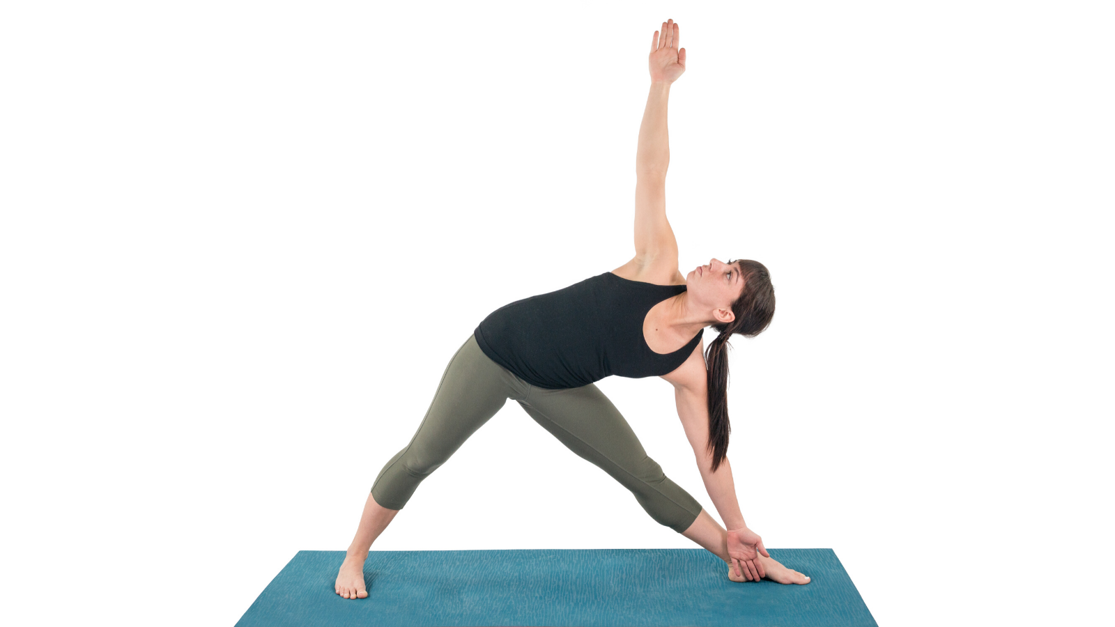 Woman practicing yoga in Triangle Pose