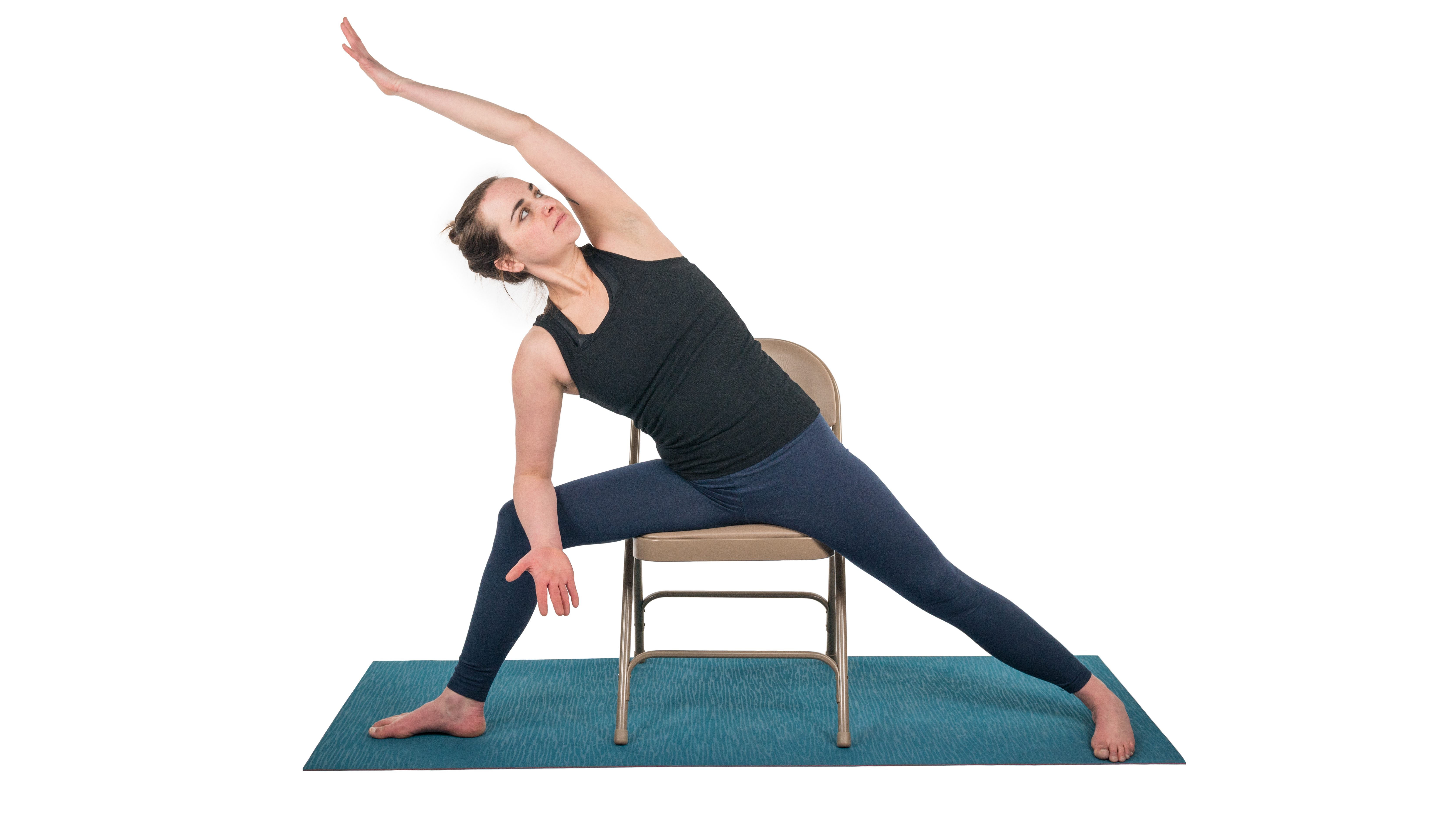 woman practicing extended side angle in a chair