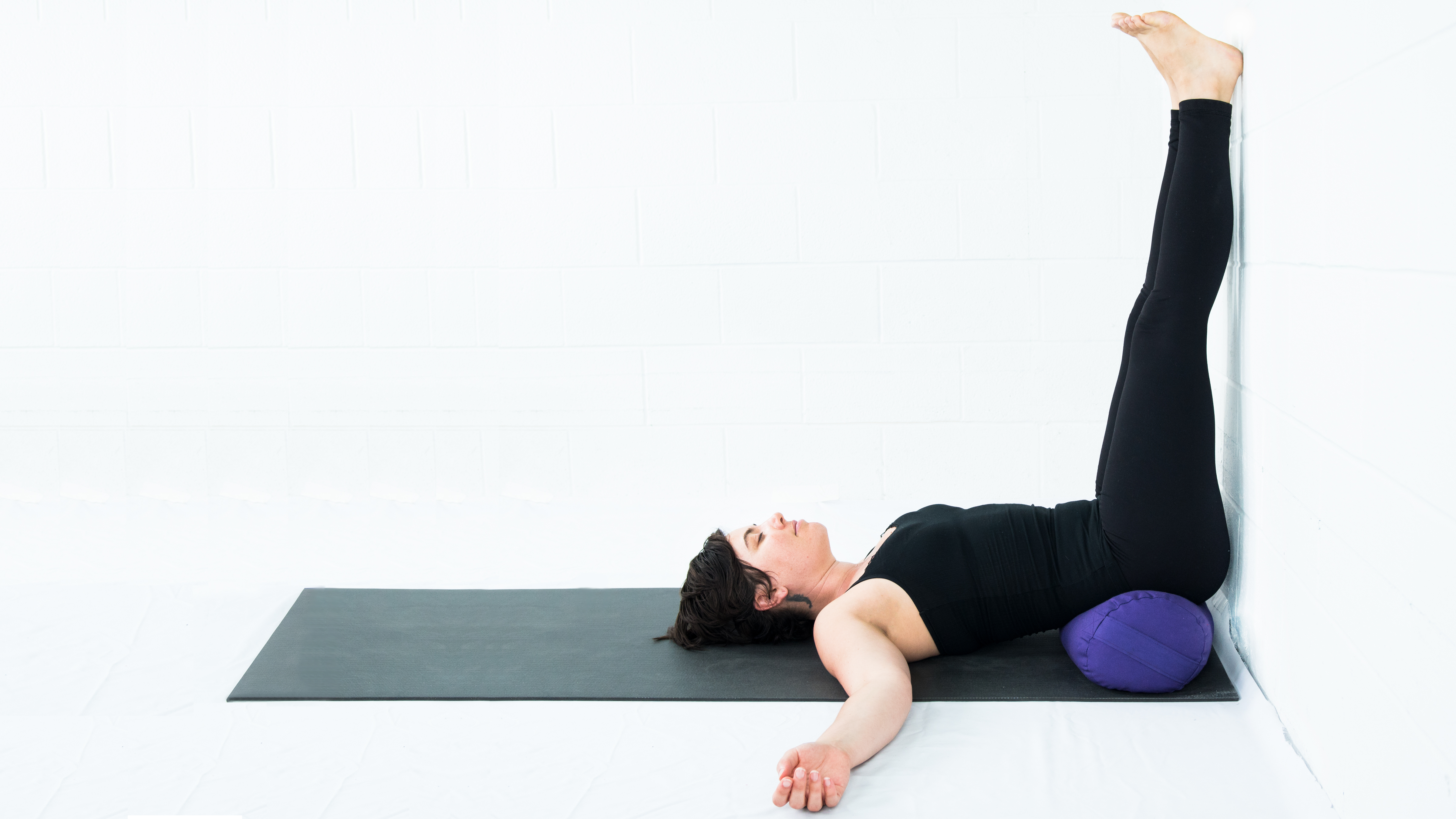 Viparita Karani, Legs up the wall, restorative yoga, yoga with props, yoga at the wall for support, yoga fro stress relief