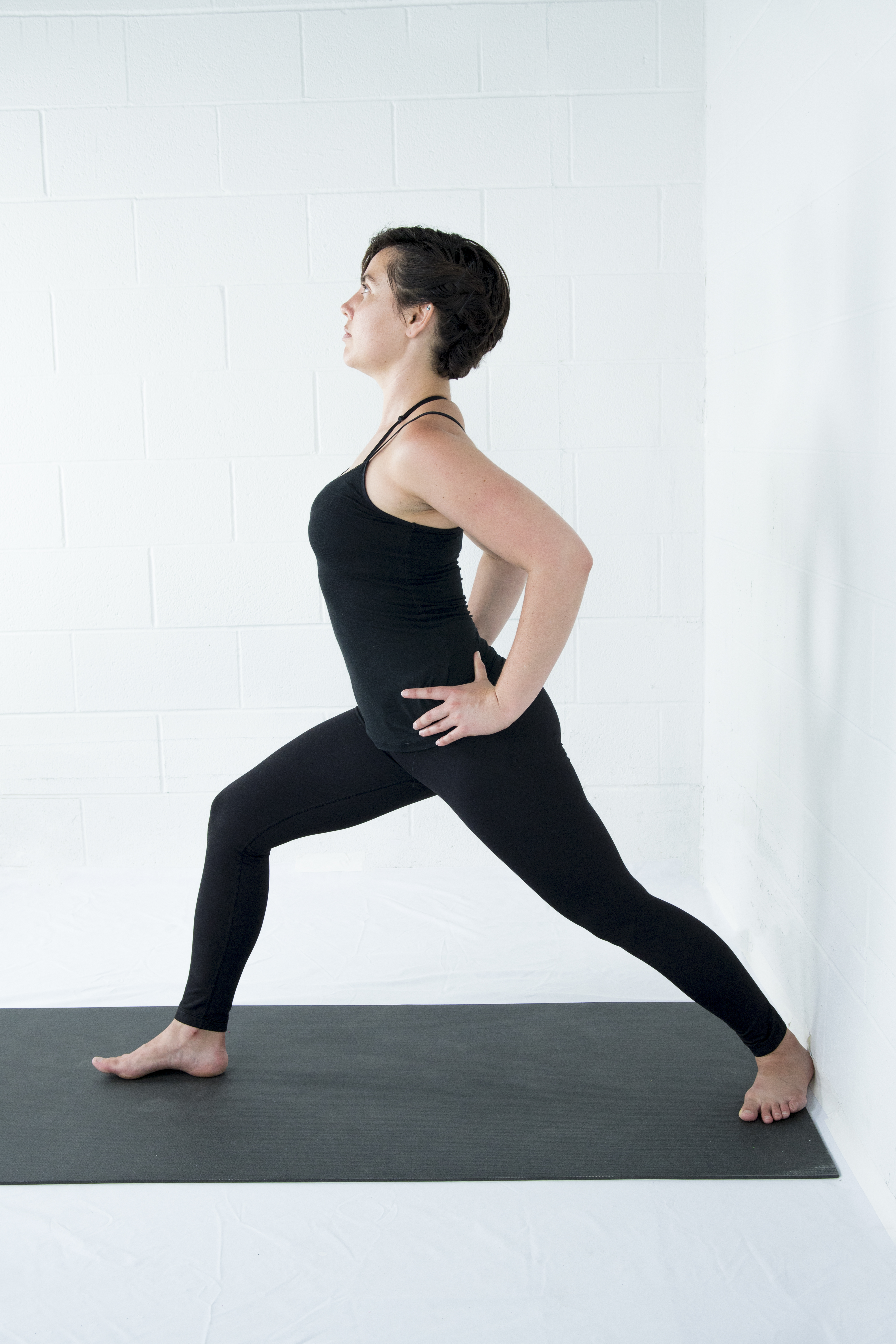 Virabhadrasana 1, Warrior 1, standing pose, strengthening pose, beginner's yoga, warrior 1 variations, yoga foe bone health and osteoporosis