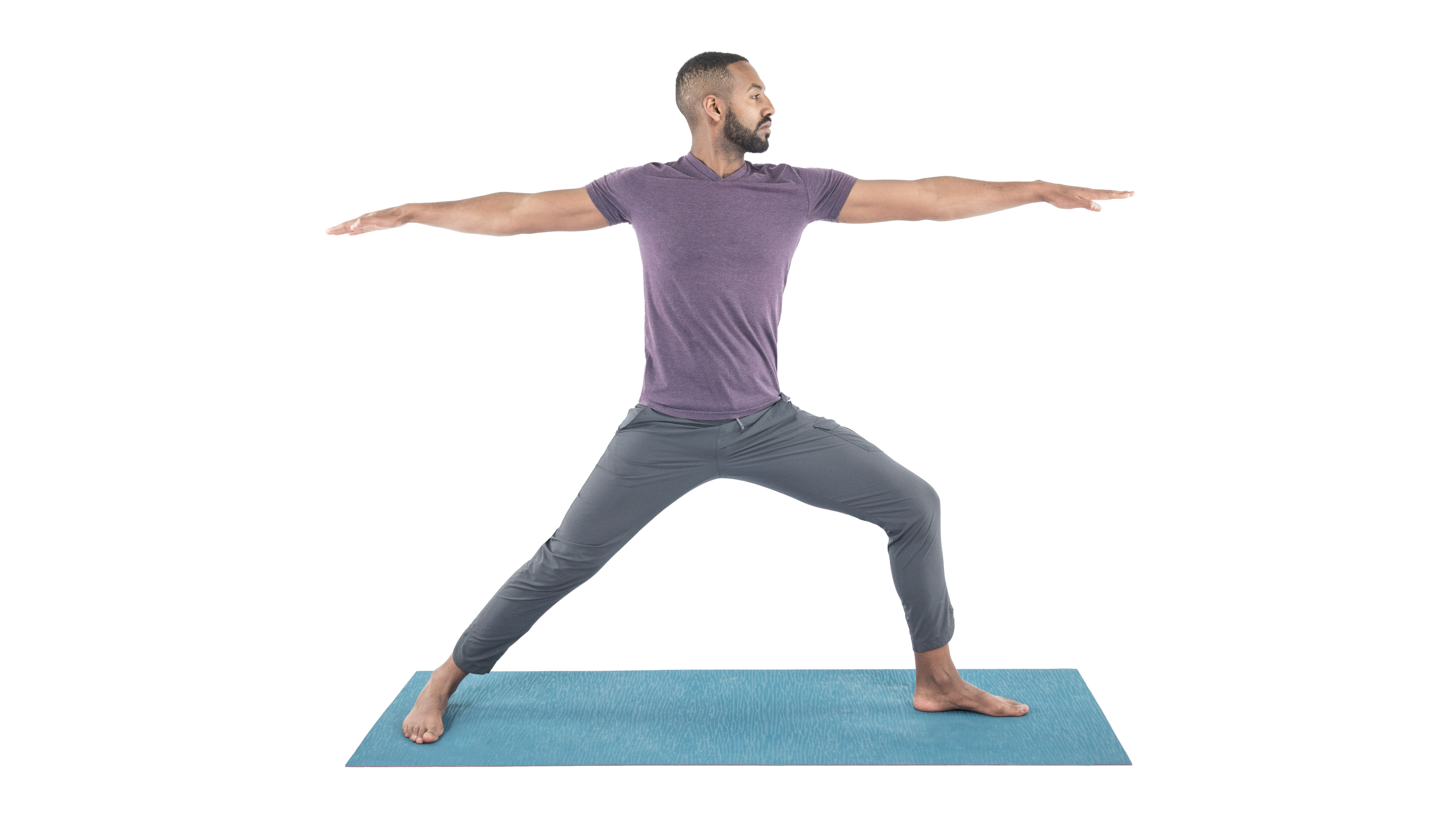 yoga man practicing virabhadrasana 2, warrior 2 pose