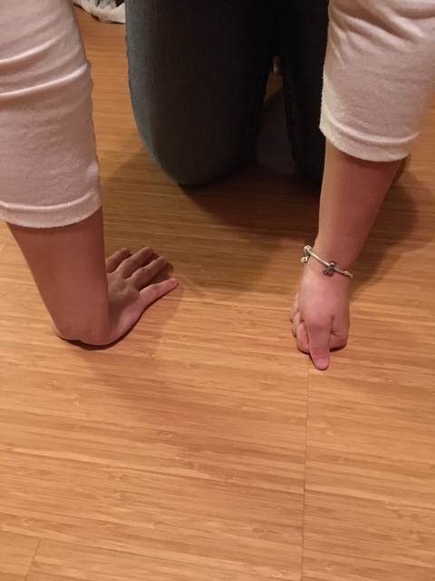 Stretching wrists exercise after arm strengthening yoga poses