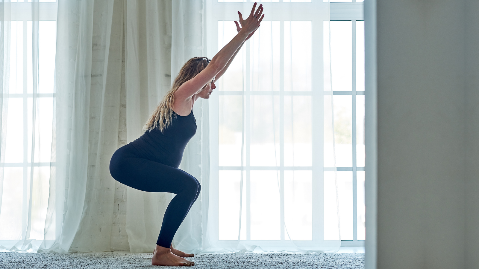 Pregnant woman practicing yoga and meditation in home
